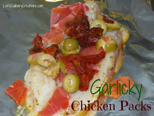 Garlicky Chicken Packets with Olive and Sun Dried Tomatoes