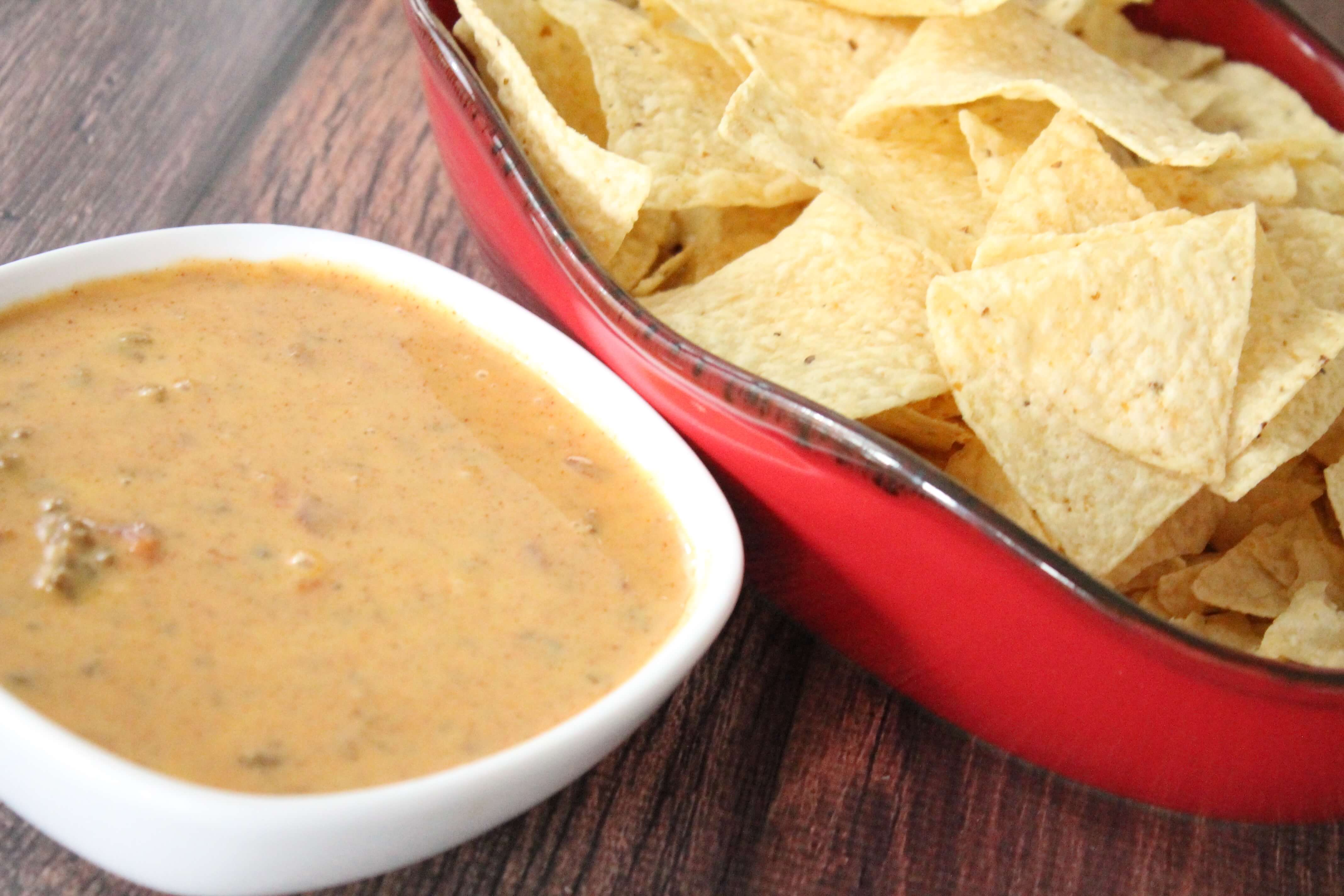 This Crockpot Party Queso Recipe is delicious and SUPER easy to make! If you're having a party of any kind or you just have a big family, give this awesome recipe a try!
