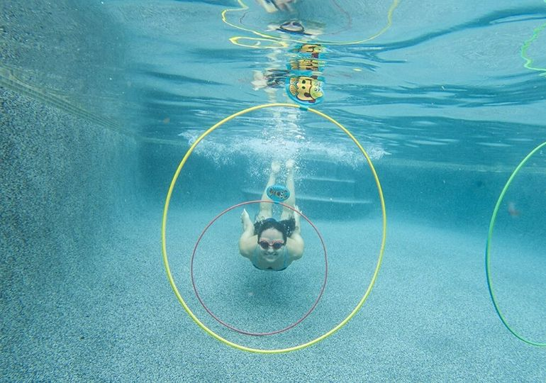 pool diving toys on sale - girl swimming through rings