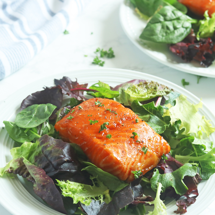 salmon over a bed of greens