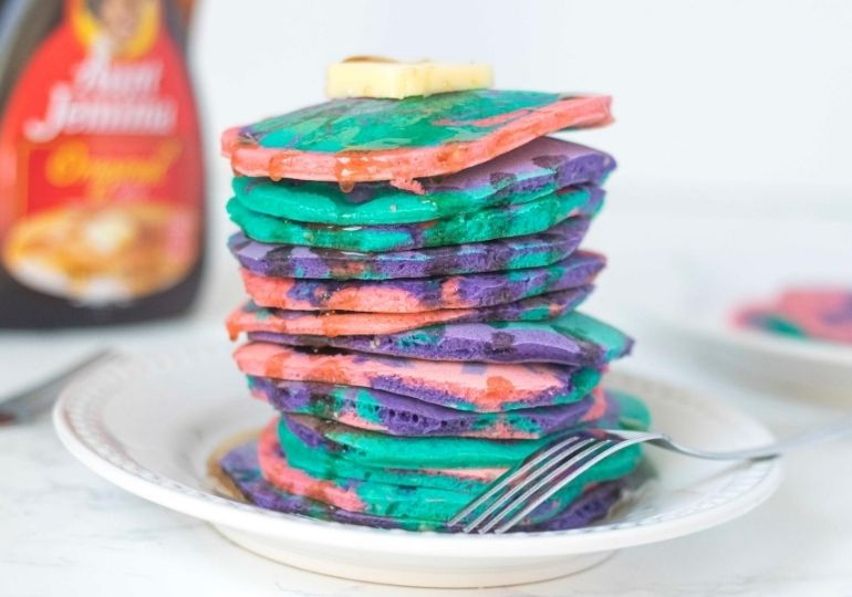 stack of pancakes on a white plate