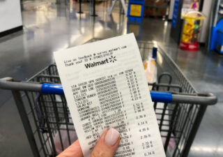 Walmart Savings Hacks - Holding a Walmart receipt