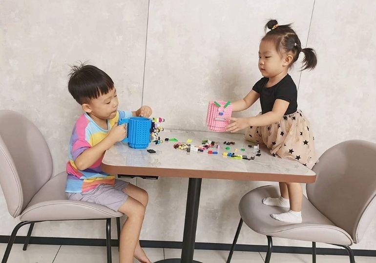Build-On-Brick Mug - kids playing with brick mug