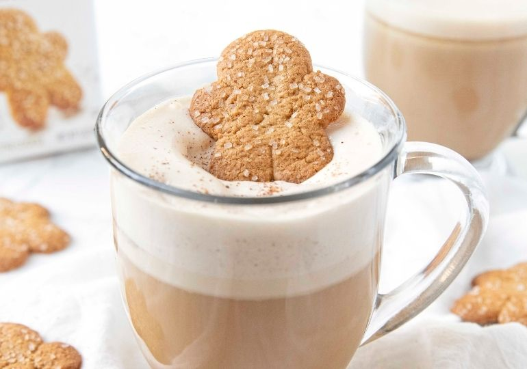 gingerbread hot drink on table in a clear cup