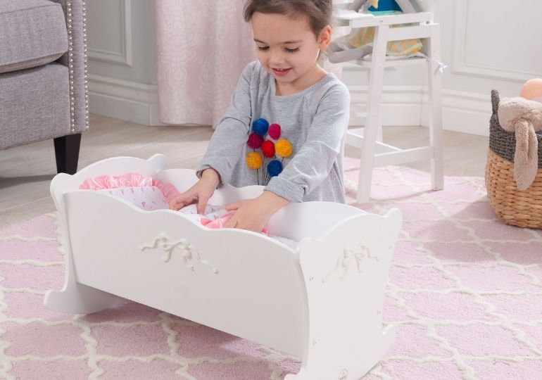 KidKraft Doll Cradle on Sale - girl playing with doll cradle