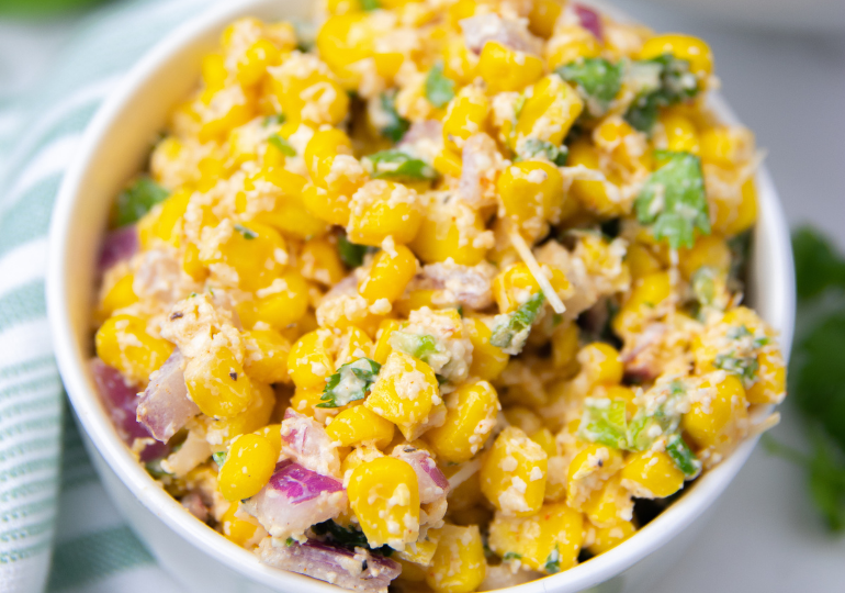 street corn salad in a white bowl